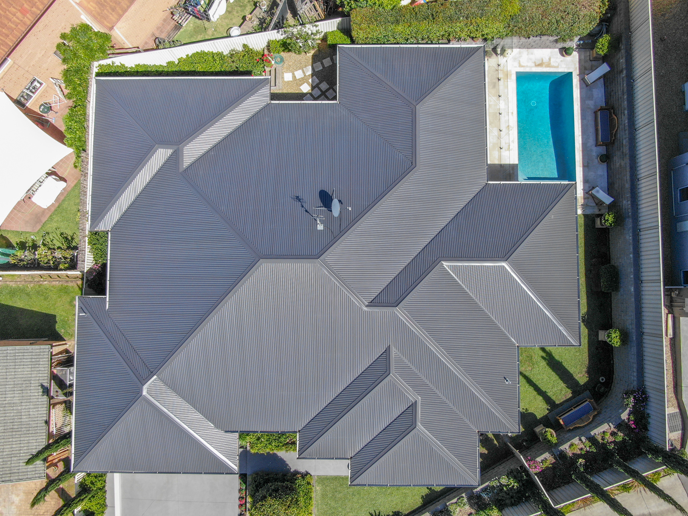 Birdeye view of residential property roof in Colorbond Ironstone.